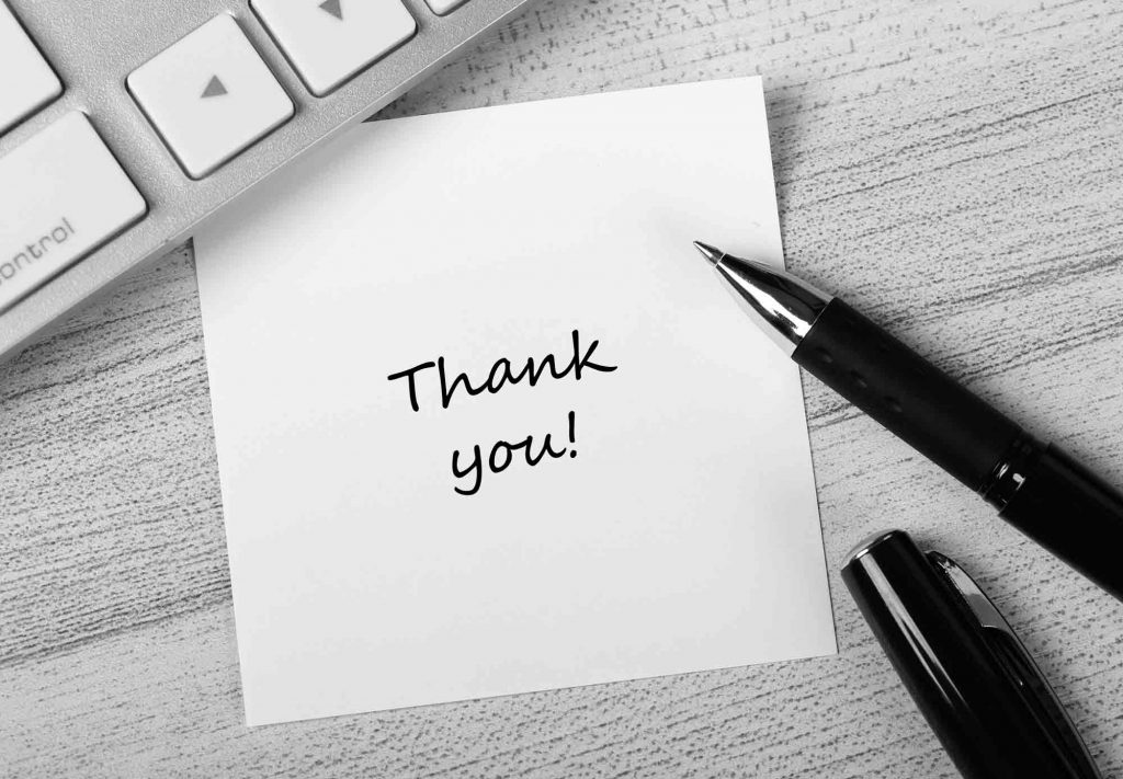 """Hand written note with """"thank you"""" to clients"""
