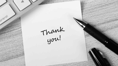 "Hand written note with ""Thank you"" to clients"